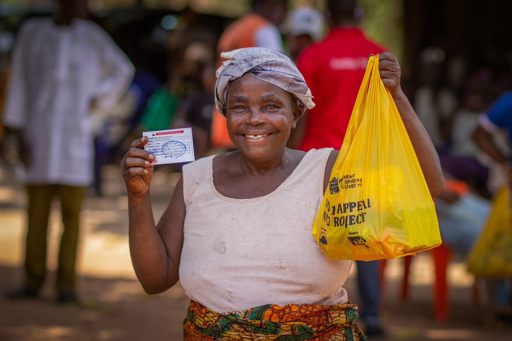 A woman receiving her hygiene kit at a Christian Aid facility in Nigeria