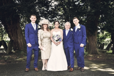 Kelly (centre) pictured with her mum, granddad and brothers